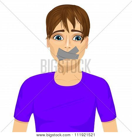 young man silenced with wouth covered with grey duct tape