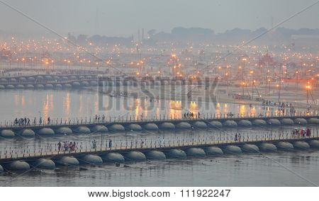 ALLAHABAD, INDIA - FEBRUARY 06, 2013: Thousands of Hindu devotees crossing the pontoon bridges over the Ganges River at Maha Kumbh Mela festival in Allahabad, India.