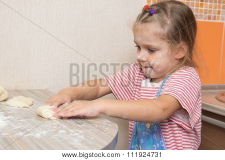 Girl Sculpts Cakes At The Kitchen Table