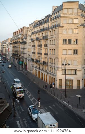 FRANCE, PARIS - SEP 10, 2014: Cityscape of street with a traffic and crosswalk.