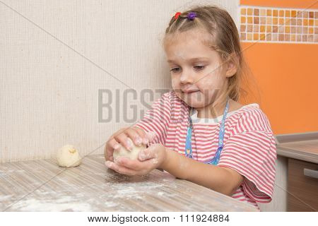 Girl Sculpts A Pie At The Kitchen Table