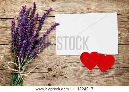 Salvia Flowers And Greeting Card With Two Red Hearts On Wooden Background