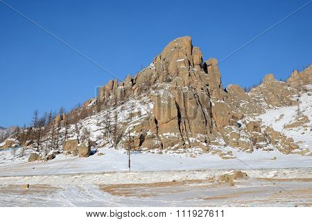 Picturesque rock in a snow-covered steppes