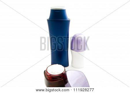 Deodorant, Cream And Shampoo On White