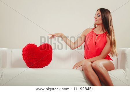 Sad Woman With Heart Shape Pillow. Valentines Day.