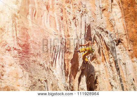 Mature male rock climber on the wall