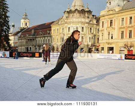 Young Man Skating On Ice Skating Rink