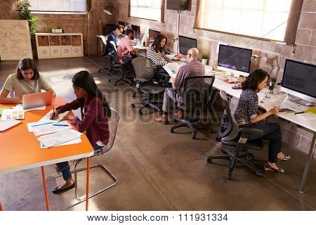 Elevated View Of People Working In Modern Design Office