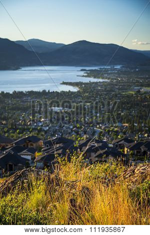 Scenic View Of Kelowna And Okanagan Valley Landscape At Sunset
