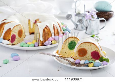 Easter cake with colorful filling and glaze