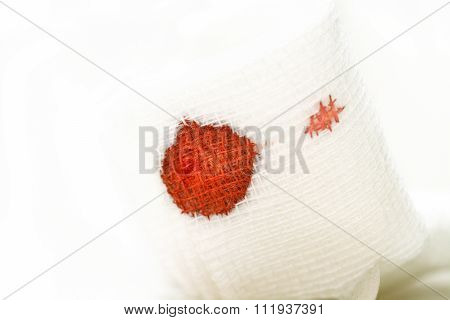 Gauze Bandage With Blood On White