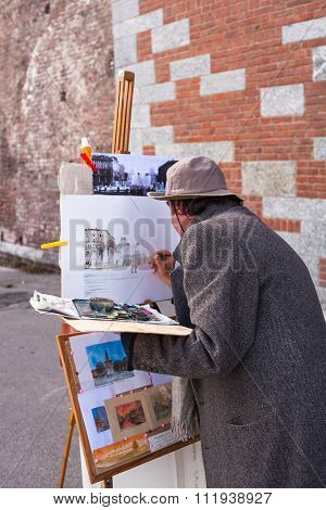 Painter Working In The Street