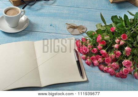 Bouquet Of Pink Roses With An Open Notebook