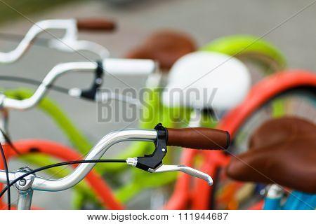 Closeup Of Bicycle's Handlebars And Saddles
