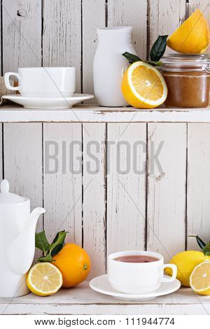 Tea with citrus fruits on the shelf