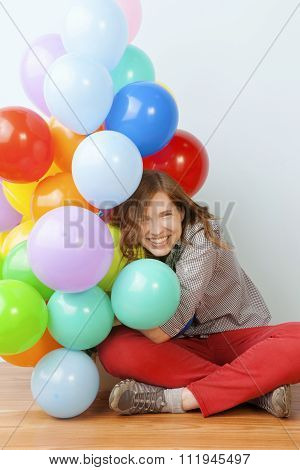 Woman Hugging Balloons