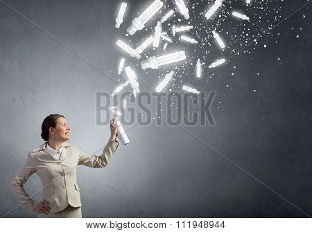 Young woman in suit and glasses using aerosol