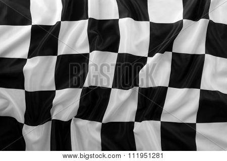 Checkered black and white flag closeup