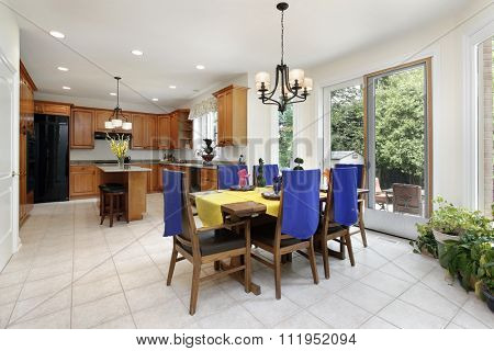 Kitchen with wood cabinetry and eating area