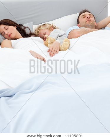 Cute Little Boy Sleeping With His Parents