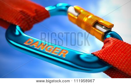 Blue Carabiner with Text Danger.