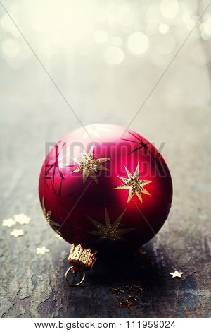 Red Christmass bell on wooden background