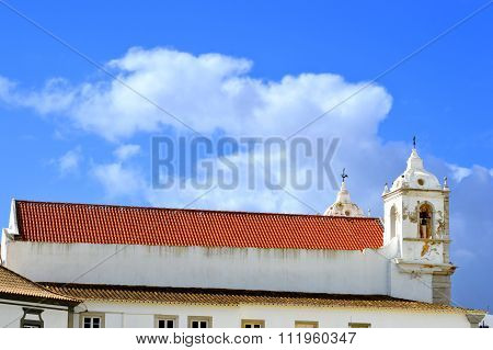 The historical Santa Maria church new roof and old bell tower in Lagos