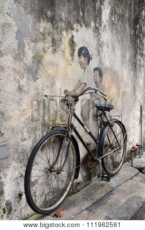 Little Children On A Bicycle Street Art Mural By Lithuanian Artist Ernest Zacharevic In Georgetown,