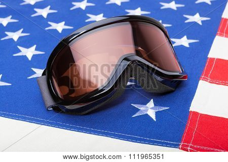 Winter Sports Implements Over Usa Flag - Snowboard Or Ski Goggles