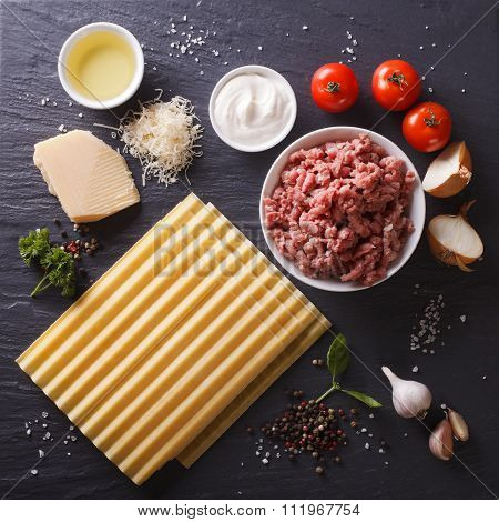 Set Of Ingredients For Cooking Lasagna Close-up. Top View Background