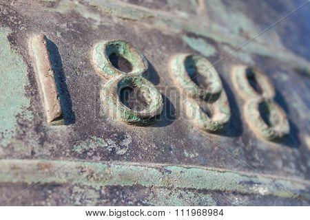 The Numbers 1898 On A Brass Bell
