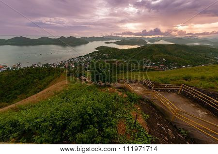 Long Staircase leading down from the mountain in front of sky with purple clouds skyline