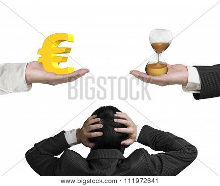 Euro Sign And Hour Glass With Businessman Hand Holding Head