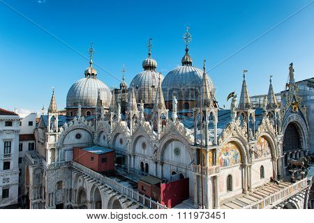 VENICE, ITALY - 17 OCTOBER 2015: Roof architecture details of Basilica San Marco (Saint Mark's basilica) . Venice, Italy on 17 October 2015.