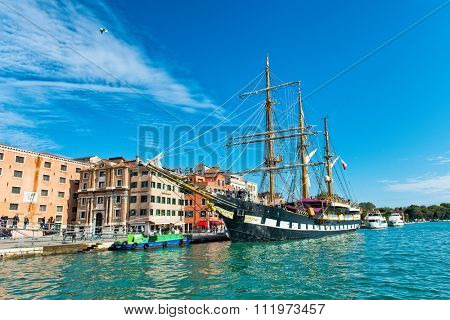 VENICE, ITALY - 17 OCTOBER 2015: Italian navy training ship, the Palinuro, a historic barquentine, moored in Venice, Italy in the Giudecca canal. Venice, Italy on 17 October 2015.
