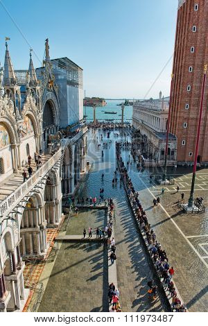 VENICE, ITALY - 17 OCTOBER 2015: St. Marks Square (Piazza San Marco) during high tide (acqua alta) in Venice, Italy. Acqua alta is an unusual high tide, which floods parts of Venice. October 17 2015.
