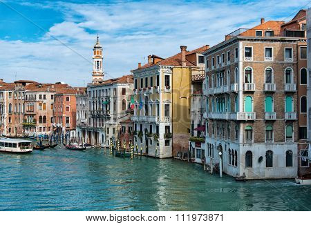 VENICE, ITALY - 17 OCTOBER 2015: Gondolas and a vaporetto, or water bus, on the Grand Canal, Venice , Italy with a view of the historical architecture of the city. Venice, Italy on 17 October 2015.