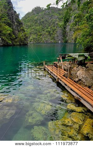Very Clean and Clear lagoon lake Water next to a wooden path