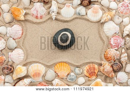 Rock Cairn On The Sand Among Sea Shells