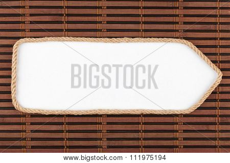 Pointer Made Of Rope With A White Background On The Bamboo Mat