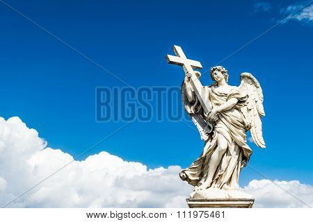 Beautiful angel with Cross in the Bridge of Saint Angelo Castle, Rome, Italy