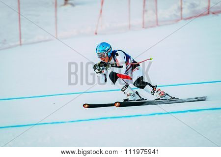 downhill young man athlete skiing to competition Russian Cup in alpine skiing