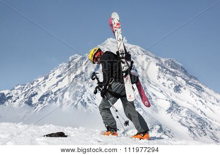 Ski Mountaineer Climb On Mountain On Background Volcano