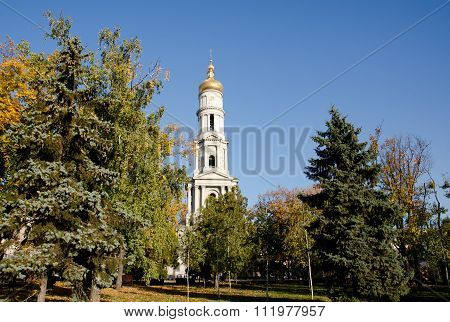 Cathedral Of The Assumption In Kharkov, Surrounded By Trees On The Background Of A Cloudless Sky