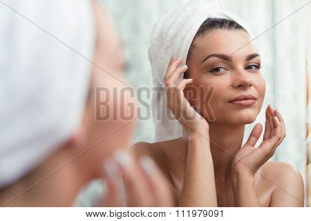Self-confident Brunette Looking At Reflection