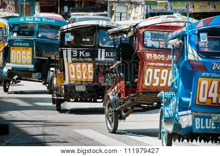 Filipino Tricycles Caught Up In a Traffic