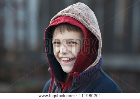 Portrait Of A Little Happy Homeless Boy