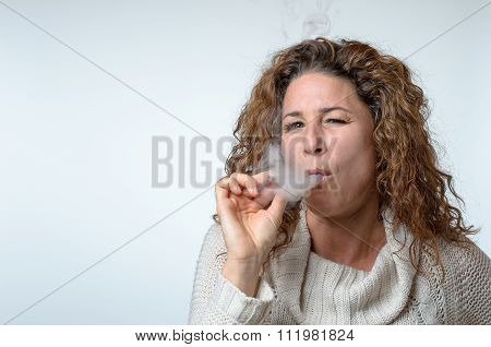 Attractive Young Woman Puffing On A Cigarette