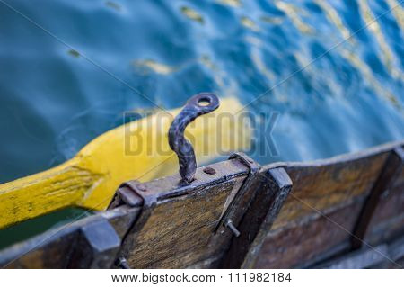 Boat And Its Oar In Water