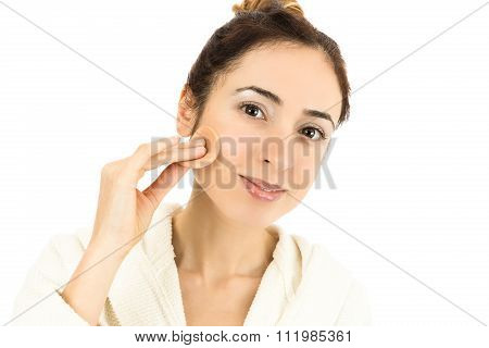 Woman With Her Make Up Sponge